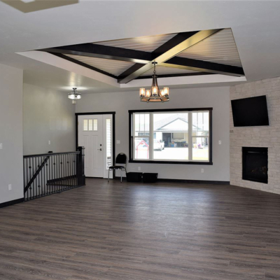 1745 Steiner Lane living room, lower level entry stairs, and indoor front entry